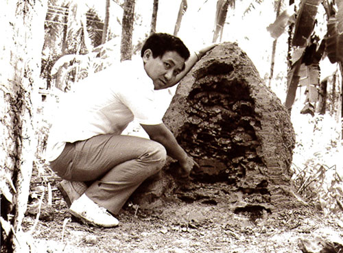 The late Dr Tho examining a termite mound
